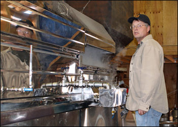 Mark next to the sugarhouse evaporator